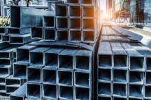 Neatly Stacked Building Materials: Square Tube Aluminum Alloy.