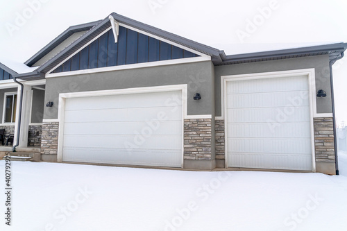 Photo Facade of home with garage entrance adjacent to the porch and entrance