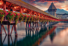 Сharm Of The Ancient Cities Of Europe. Famous Old Wooden Chapel Bridge (Kapellbrucke), Landmark 1300s Wooden Bridge, Lucerne Cityscape, Switzerland, Europe.