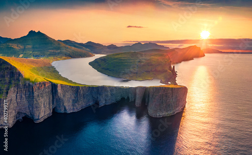 Magnificent evening view from flying drone of Sorvagsvatn lake, Vagar, Faroe Islands, Denmark, Europe. Majestic summer sunset on Atlantic Ocean. Beautiful summer scenery..