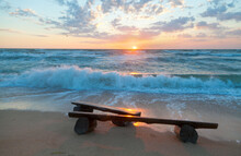 Sunrise Over The Sea, Wooden Benches On The Beach.