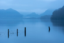 Stunning Landscape Image Of Misty Derwentwater In Lake District On Cold Winter Morning