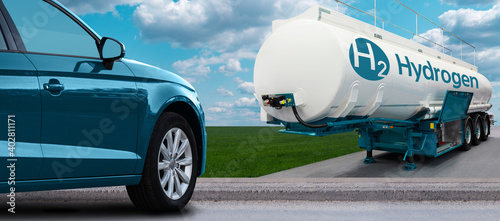 Valokuva Blue car on hydrogen fuel with H2 tank trailer on a background of green field an