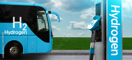 Tourist bus on hydrogen fuel with H2 filling station on a background of green field and blue sky