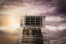 Phone In A Cage On The Top Of A Mountain At Sunset Magenta Day. Phone Is Prisoner In Metal Cage Or No Freedom For Technology Concept. 3D Illustration