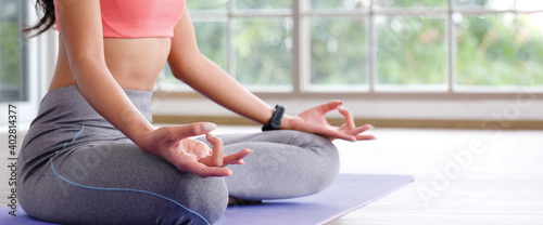 Fototapeta Close up of woman hand practice yoga meditation exercise at home with copy space