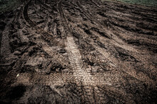 Tyre Track On Dirt Sand Or Mud, Picture In Retro Or Grunge Tone. Car Drive On Sand. Off Road Track. Track On Grass Field. Track In Farm.