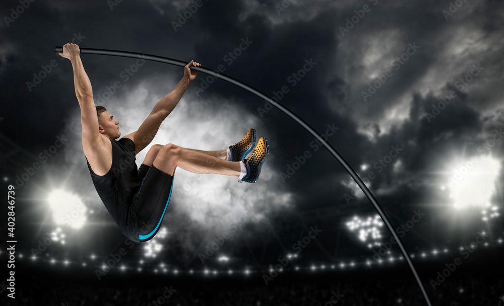 Obraz Professional pole vaulter training at the stadium in the evening fototapeta, plakat