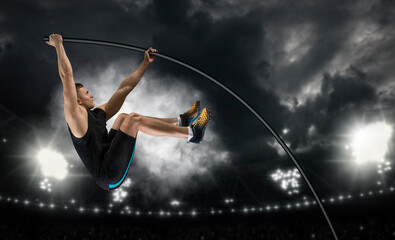 Professional pole vaulter training at the stadium in the evening