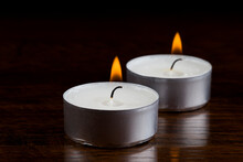 Burning Tealight Candle Pair In The Dark Closer
