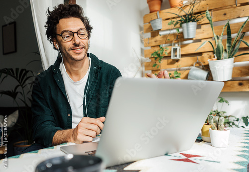 Tela Man with laptop working remotely from home