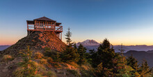 Panoramic View Of A Fire Lookout With Mt Rainier In The Background During The Sunset