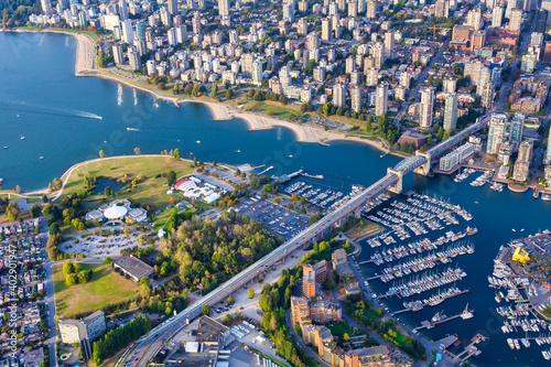 Aerial Photography of False Creek in Downtown Vancouver, British Columbia (BC), Canada, on a sunny sunset. Modern City on the Pacific West Coast.