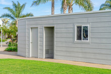 Single Storey Building Facade With Gray Wall And Flat Roof In Huntington Beach