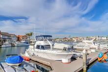 Yachts On Boat Docks At Huntington Beach California Harbor On A Sunny Day