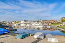 Huntington Beach California Harbor With Seaside Sceneries And Waterfront Homes