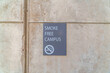 Smoke Free Campus sign on exterior wall of school building in San Diego CA