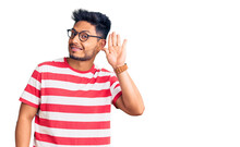 Handsome Latin American Young Man Wearing Casual Clothes And Glasses Waiving Saying Hello Happy And Smiling, Friendly Welcome Gesture