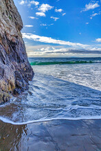 Ocean And Foamy Waves With Rocky Mountain In Laguna Beach California Landscape