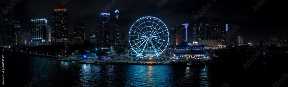Fototapeta Night aerial panorama Miami Skyviews ferris wheel at Bayside Marketplace reflection in water