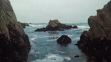 Looking Out Of A Beautiful Rocky Cove At The Waves In Monterey California 4k Rock Formations