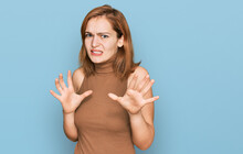 Young Caucasian Woman Wearing Casual Clothes Disgusted Expression, Displeased And Fearful Doing Disgust Face Because Aversion Reaction. With Hands Raised