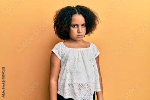 Fotografie, Obraz Young little girl with afro hair wearing casual clothes skeptic and nervous, frowning upset because of problem