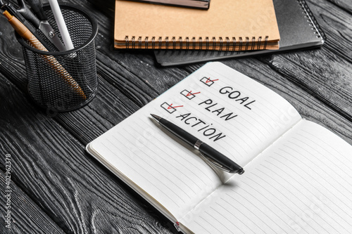 Obraz Text GOAL PLAN ACTION in notebook and pen on wooden background - fototapety do salonu