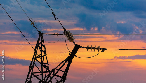 Obraz na plátně Electric pole with wires at sunset.