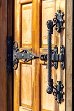 Forged Handle And Forged Bolt On An Antique Wooden Door