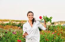 Outdoor Portrait Of Happy Woman Workong In Flower Garden, Hobby And Leisure Activities