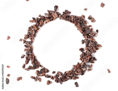 Fototapeta Chopped, grated cocoa pieces round frame and border, isolated on white background obraz