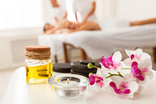 Couples Massage Spa Composition With Stones, Oil And Orchid Flowers