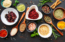 Various Spices In A Bowls On A Black