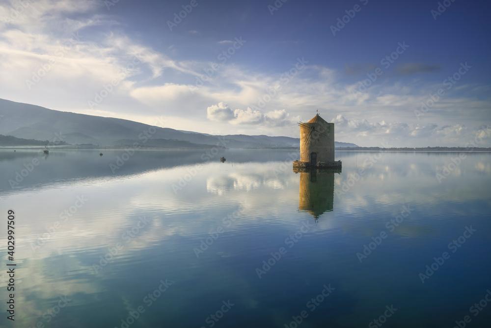 Old spanish windmill in Orbetello lagoon, Argentario, Italy.