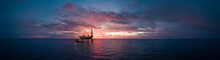 Aerial Panorama View From A Drone Of An Offshore Jack Up Rig During Sunset Time At The Offshore Location