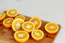 Top View Of Fresh Cut Oranges On Brown Cutting Board. Many Slices, Natural Light. Natural Beverages