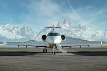 Private Jet Airplane On The Ground Waiting To Be Boarded Snowy Mountains In The Background