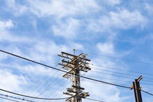 Top Of An Old Metal Power Tower With Cables, Bright Blue Sky Copy Space, Horizontal Aspect
