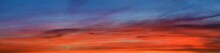 Epic Dark Sunset Sky Above The Sea Shore After The Storm. Dramatic Glowing Golden And Red Clouds, Natural Texture, Background. Fickle Weather, Climate Change, Ecology. Panoramic View, Copy Space