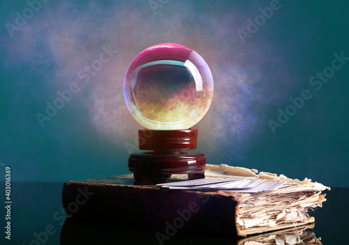 Fotografering Spell book, crystal ball of fortune teller and cards on table