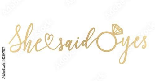 Valokuva She said yes golden lettering sign