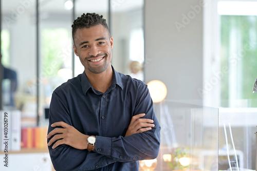 Obraz Portrait of african american businessman in co-working office - fototapety do salonu