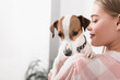 blurred cheerful woman holding in arms jack russell terrier