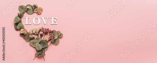 Obraz Creative flat lay of word love on soft color  background with natural plants - fototapety do salonu