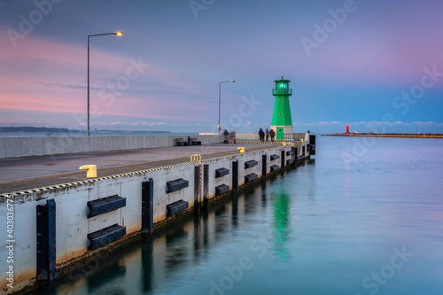 Lighthouse on the west breakwater in Nowy Port at dusk, Gdańsk. Poland - fototapety na wymiar
