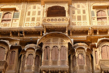 Beautiful Details Carved Facade Wall And Windows Exterior Architecture In Patwon Ki Haveli In Jaisalmer, Rajasthan India. This Is Famous Haveli Architecture In Rajasthan.