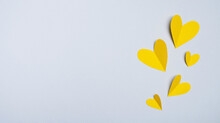 Valentines Day. Yellow Hearts Made Of Paper On Gray Background. Minimal Composition In Trendy Colors. Top View, Flat Lay, Copy Space