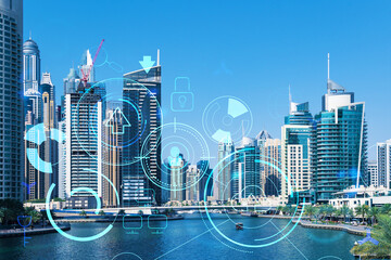 Skyscrapers of Dubai business downtown. International hub of trading and financial services. Technology theme icons hologram, concept of big data. Double exposure. Dubai Canal waterfront.