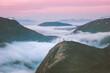 Leinwandbild Motiv Traveler hiking above mountain clouds enjoying Norway sunset landscape travel adventure lifestyle vacation outdoor epic trip